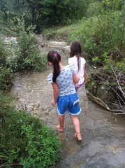 two little girls in the river