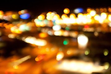 Fotobehang - golden bright lights on dark night background