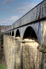 Aqueduct. Canal aqueduct bridge spanning river.