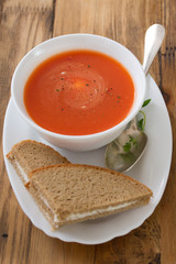 tomato soup in white bowl with bread