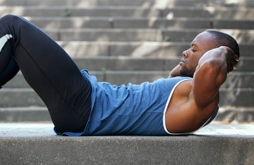 Fit african american man doing stomach crunches
