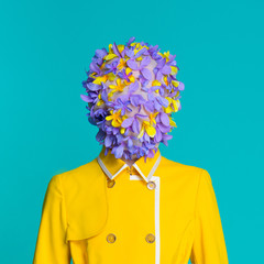 Fashion model in yellow coat and art accessories posing in the