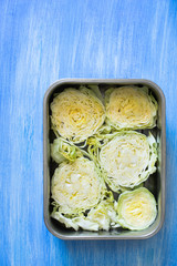Raw cabbage slices prepared for baking in oven