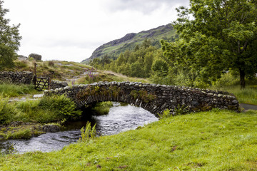 Stone Bridge over Watendlath Beck, Watendlath, English Lake District, Cumbria, England, UK.