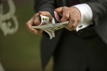 Magician shuffling cards
