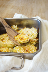 Closeup of baked slice of cabbage in baking form