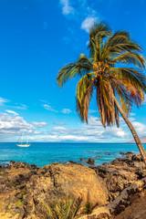 A sailboat moored off the coast of Kamaole Beach in Kihei on Maui, Hawaii