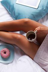 Woman having breakfast in the bed