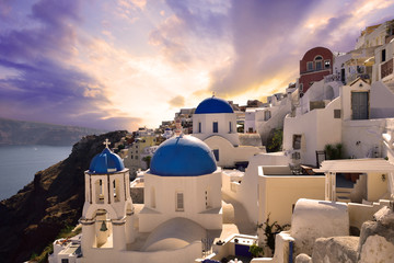 Sunset over the famous village Oia in Santorini, Greece