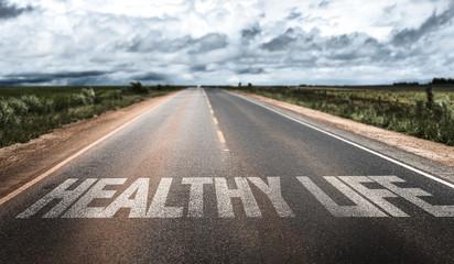 Fototapeta Healthy Life written on rural road obraz