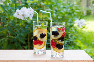 Infused water with berries and golden kiwi. Refreshing drink.