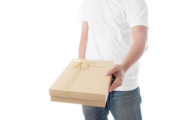 man in white t-shirt  holding  golden gift box