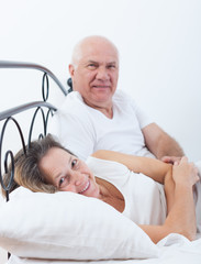 Beautiful elderly couple  in bed.