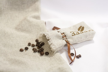 Sachet with embroidery stitch with coffee beans, selective focus