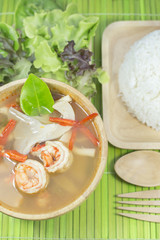 Tom yum goong homemade thai style food with wooden kitchenware