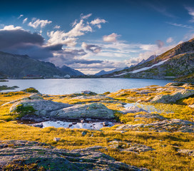 The last rays of the sun over Totensee lake on the top of Grimse