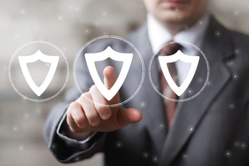 Businessman push web button with shield security virus