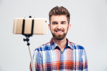 Portrait of a cheerful young man making selfie photo