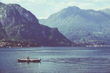 Como lake and fisherman