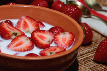 Strawberry close-up bowl with milk