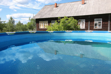 Pool in front of a country house