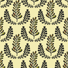 Ethnic seamless pattern with ornamental stylized leaves on yellow background. Endless texture, template for fabric