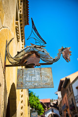 Old rusty metal dragon shop sign
