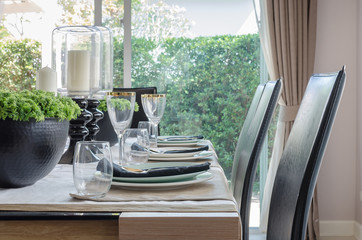 table set for dinner on dinning table with black modern chair