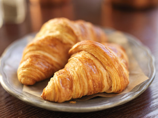 two croissants on plate and shot with selective focus