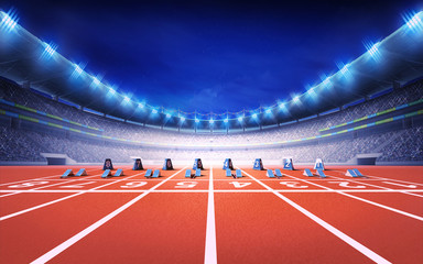 athletics stadium with race track with starting blocks front view