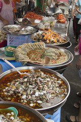 Street stalls sell all kinds of prepared food in Chinatown.Bangkok,Thailand