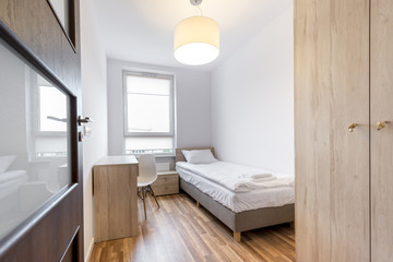 Stylish white bedroom in small room
