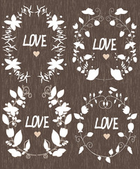 beautiful background with set of wreaths and word love on wooden texture