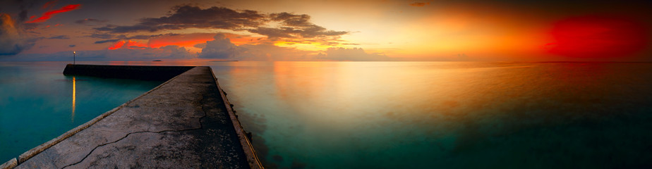 Panorama of tropical sunset on Maldives