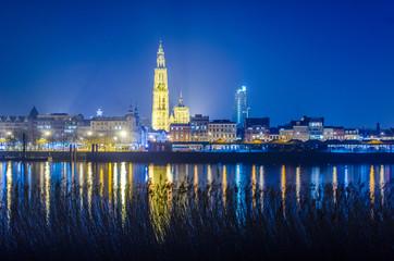 Acrylic Prints Antwerp Night view over illuminated city of antwerp in belgium taken from the opposite shore of the river scheldt/schelde.