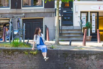Young beautiful woman walking in european city, Amsterdam