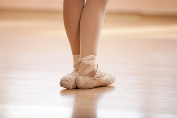 Legs of young ballerina, ballet dancing class
