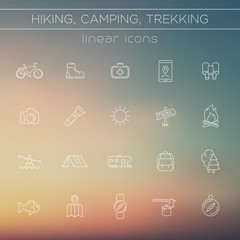 Hiking, Camping, Backpacking, Trekking line icons on blur background