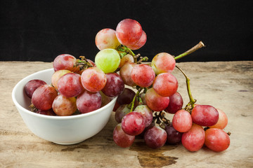 fresh fruit red grapes on wood background