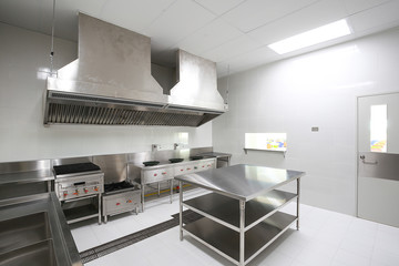 Deurstickers Industrial geb. Commercial kitchen work surface and kitchen equipment in professional kitchen.