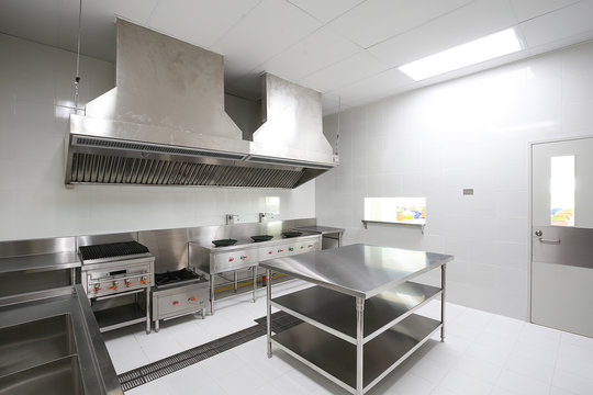 Commercial kitchen work surface and kitchen equipment in professional kitchen.