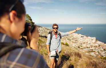 Tourist couple enjoying nature and taking photo