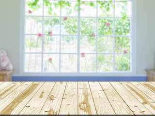 Wood table top on window interior room blurred background.