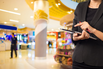 Businesswoman using digital tablet in the shopping mall.