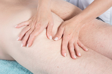 Legs and buttocks woman massage digitopuncture