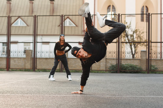 Handsome guy in a stylish black clothes dancing hip-hop. dancer