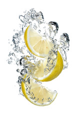 Three slices of lemon falling into water