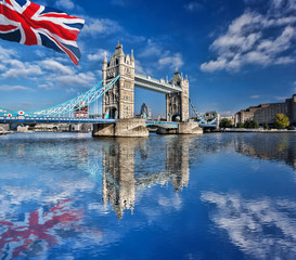 Famous Tower Bridge with flag of England in London, UK