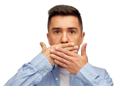 face of man covering his mouth with hand palm