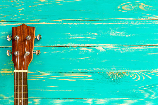 Ukulele Background / Ukulele / Ukulele on Blue Wooden Background
